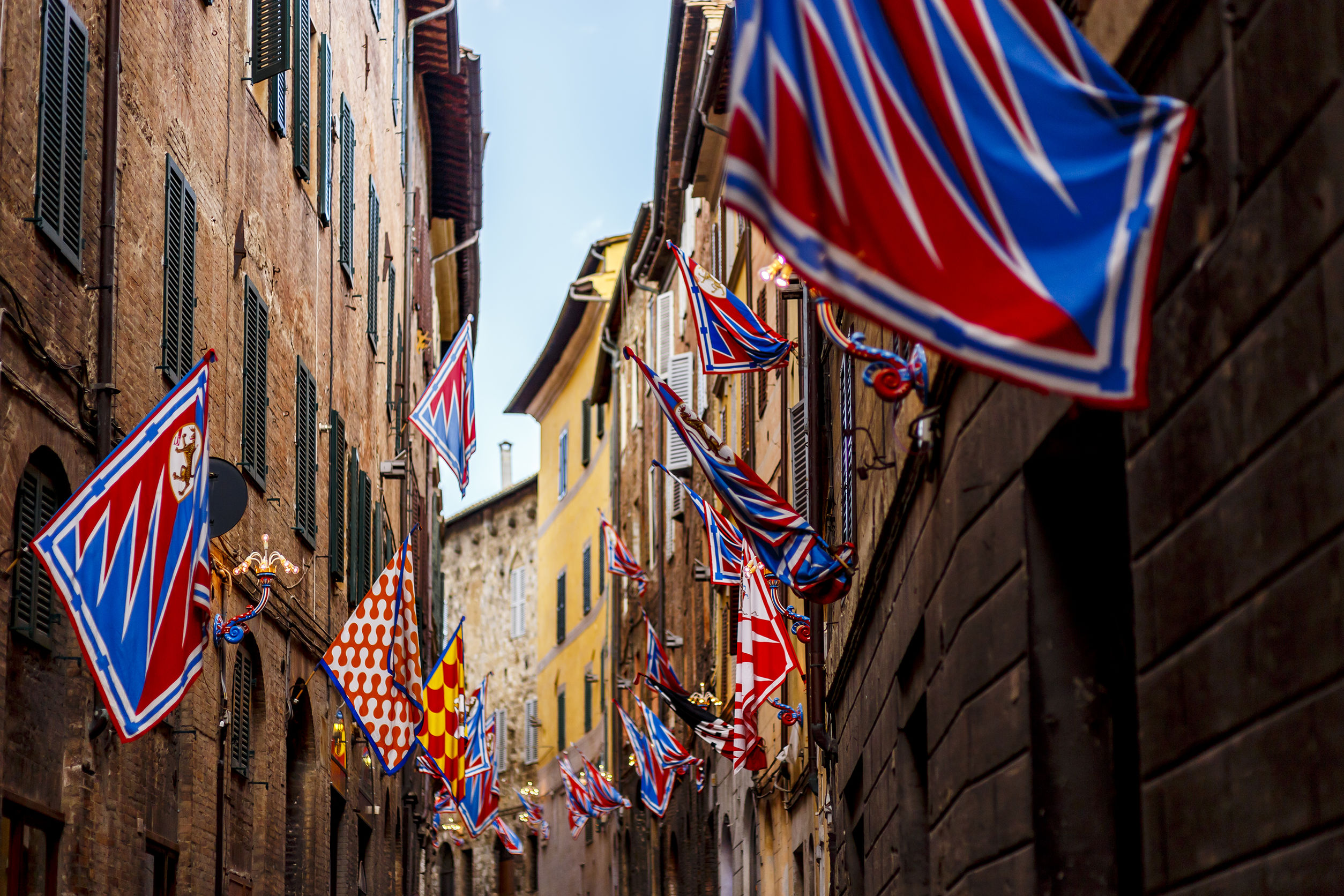 Banners of the contrads in Siena. Feast Palio. Region of Tuscany, Italy